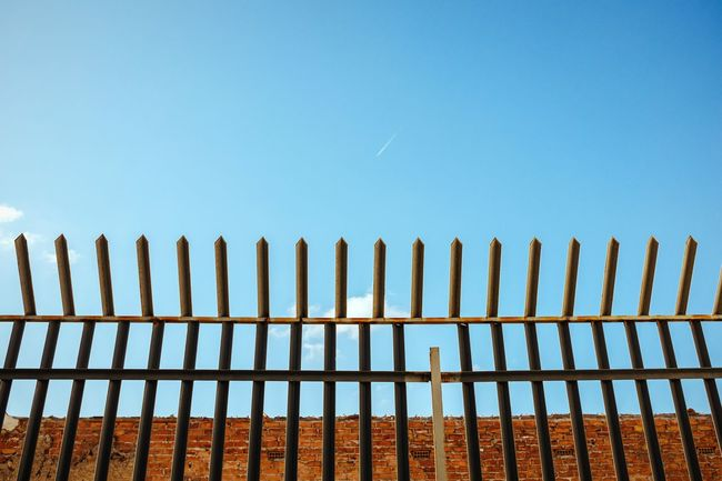 Look further Fence Picket Fence Safety Clear Sky Sunlight Outdoors No People Protection In A Row Low Angle View Sky Built Structure Perching Imprisoned Plane Blue Sky No Clouds Dreaming Dreamer Pattern Minimalism Minimalobsession Blue SPAIN Malaga