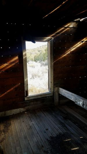 inside the old cowboy cabin Window Indoors  No People Night EyeEmNewHere Wood - Material Indoors  Home Interior Built Structure Architecture Day Nature EyeEm Ready   AI Now