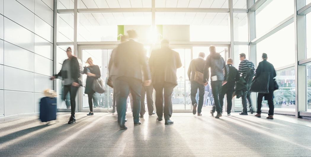 Blurred people in motion on a Airport Entrance Architecture Blurred Motion Blurred Movement Business Business Finance And Industry Business Man Businessman Businesswoman Commuter Congress Corporate Business Day Entrance Glass Indoors  Medium Group Of People Motion People And Places Real People Rush Hour Sunlight And Shadow Sunset Sunshine Walking Window