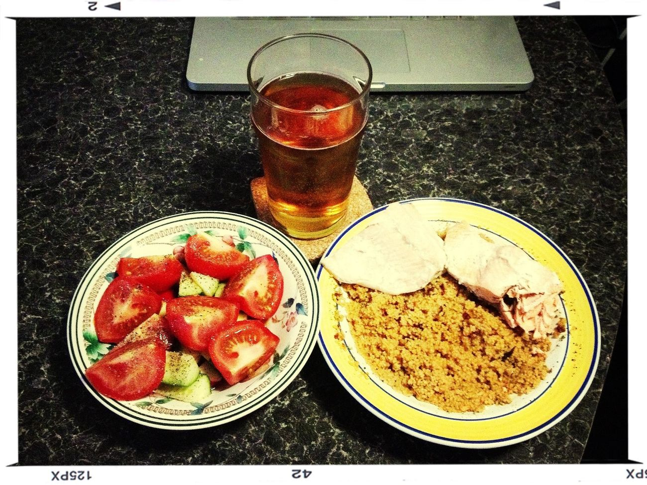 Poached salmon, cous cous with sun-dried tomatoes & garlic, tomato and cucumber salad with a soy sauce, rice vinegar & sesame oil dressing.