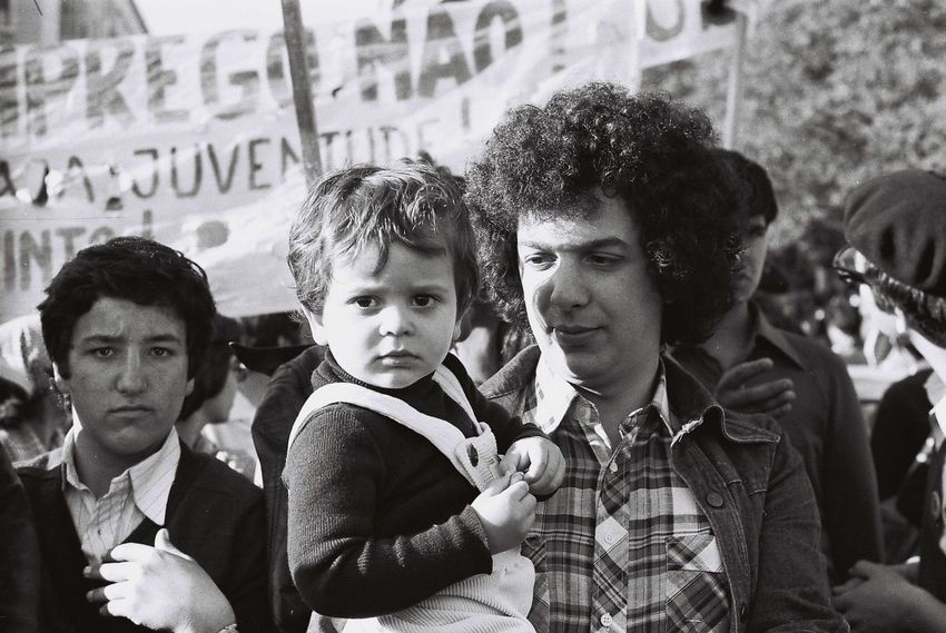 1979 Casual Clothing City Communication Day Focus On Foreground Friendship Fun Headshot Holding Looking At Camera Love Portrait Portuguese Revolution 1974 Rally Teenage Boys Text Togetherness Western Script People And Places.