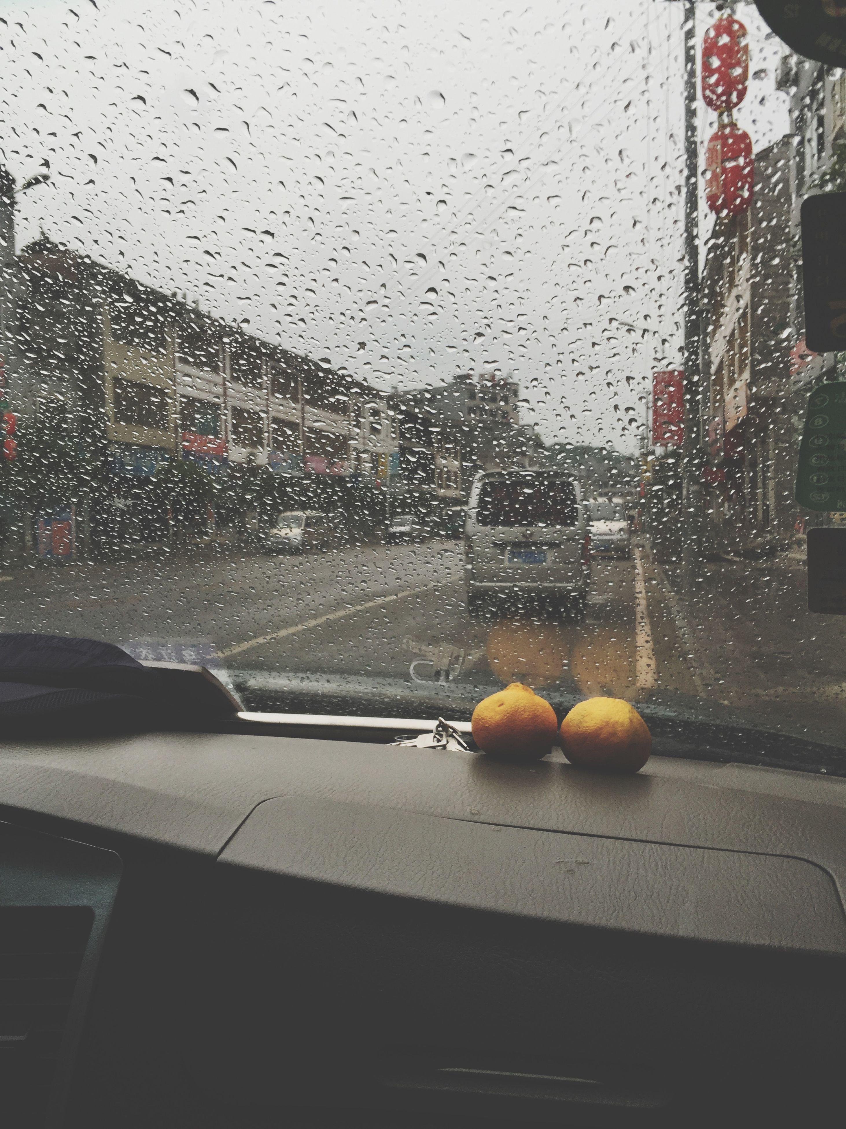 window, transparent, glass - material, wet, drop, indoors, rain, water, car, architecture, building exterior, built structure, glass, raindrop, season, weather, city, sky, transportation, land vehicle