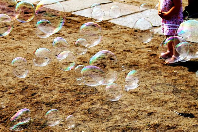 Bubble Bubbles Child Child Playing Childhood Childhood Memories Children Children Photography Childrenphoto City City Life City Street City View  Citylife High Angle View Human Hand Low Section Real People Sand Street Street Photography Streetphoto_color Streetphotography