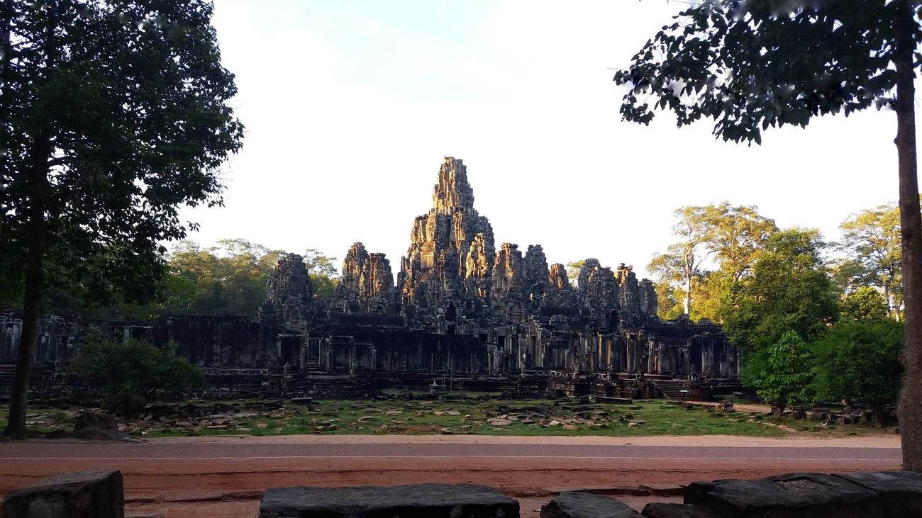 Bayon Temple of Cambodia! Follow me! Outdoors No People Day Dramatic Cambodia Khmer Temple Architecture Ancient Architecture Angkor Thom Bayon Temple Brahma Full Length Sunlight Scenery Shots Architecture Ancient Civilization Sunset Golden Hour