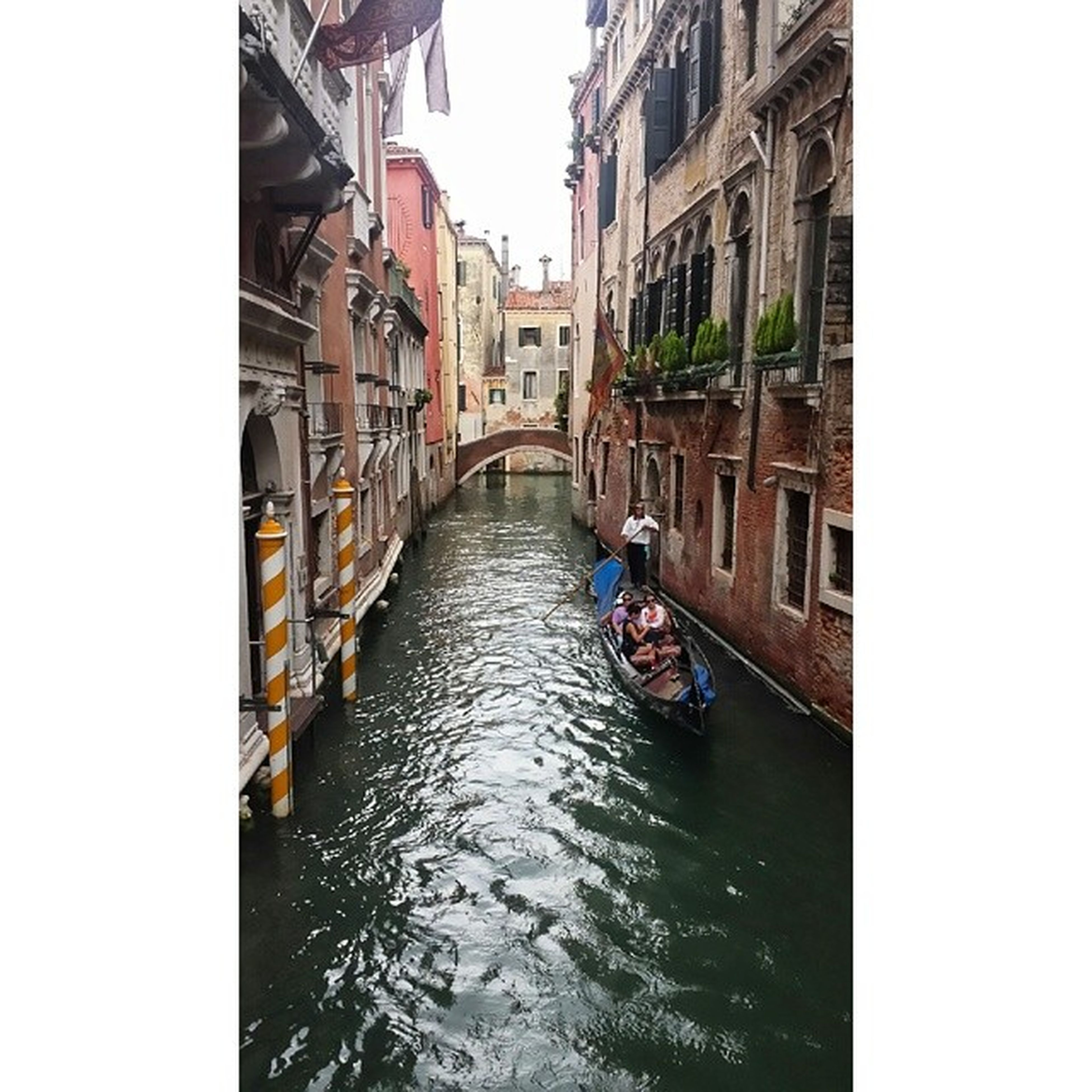 architecture, built structure, building exterior, water, canal, waterfront, transfer print, transportation, city, auto post production filter, bridge - man made structure, men, river, nautical vessel, building, clear sky, mode of transport, connection, residential building
