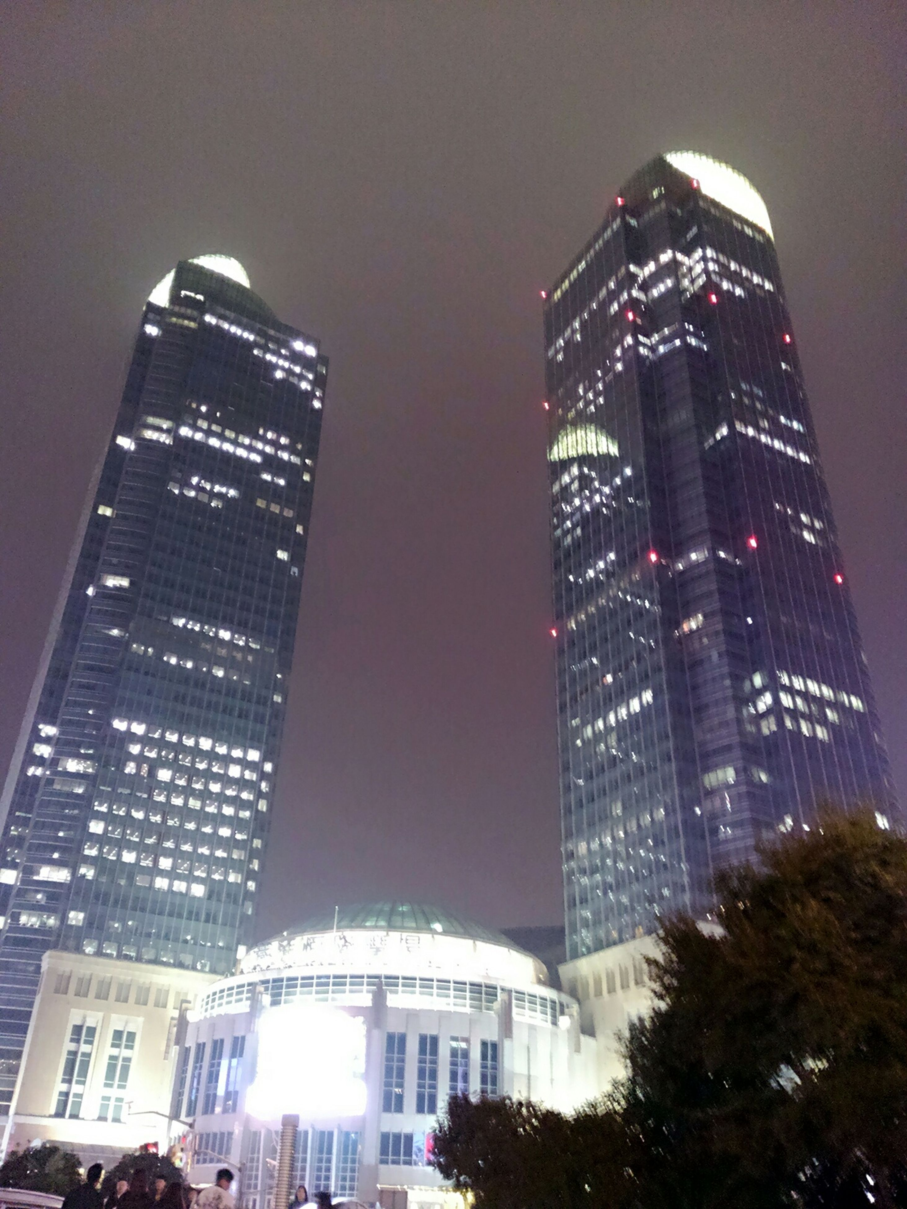 building exterior, architecture, built structure, skyscraper, city, modern, tall - high, tower, office building, low angle view, illuminated, sky, building, financial district, night, tall, urban skyline, clear sky, city life, capital cities