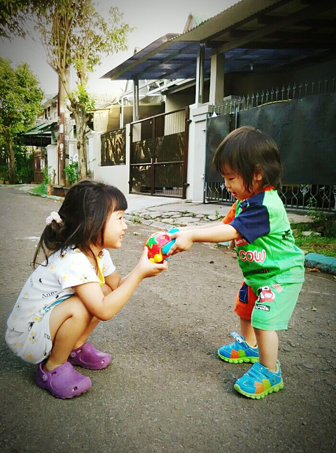 Enjoy The New Normal sisters sharing Child Girls Full Length Outdoors Friendship Childhood Bonding Togetherness