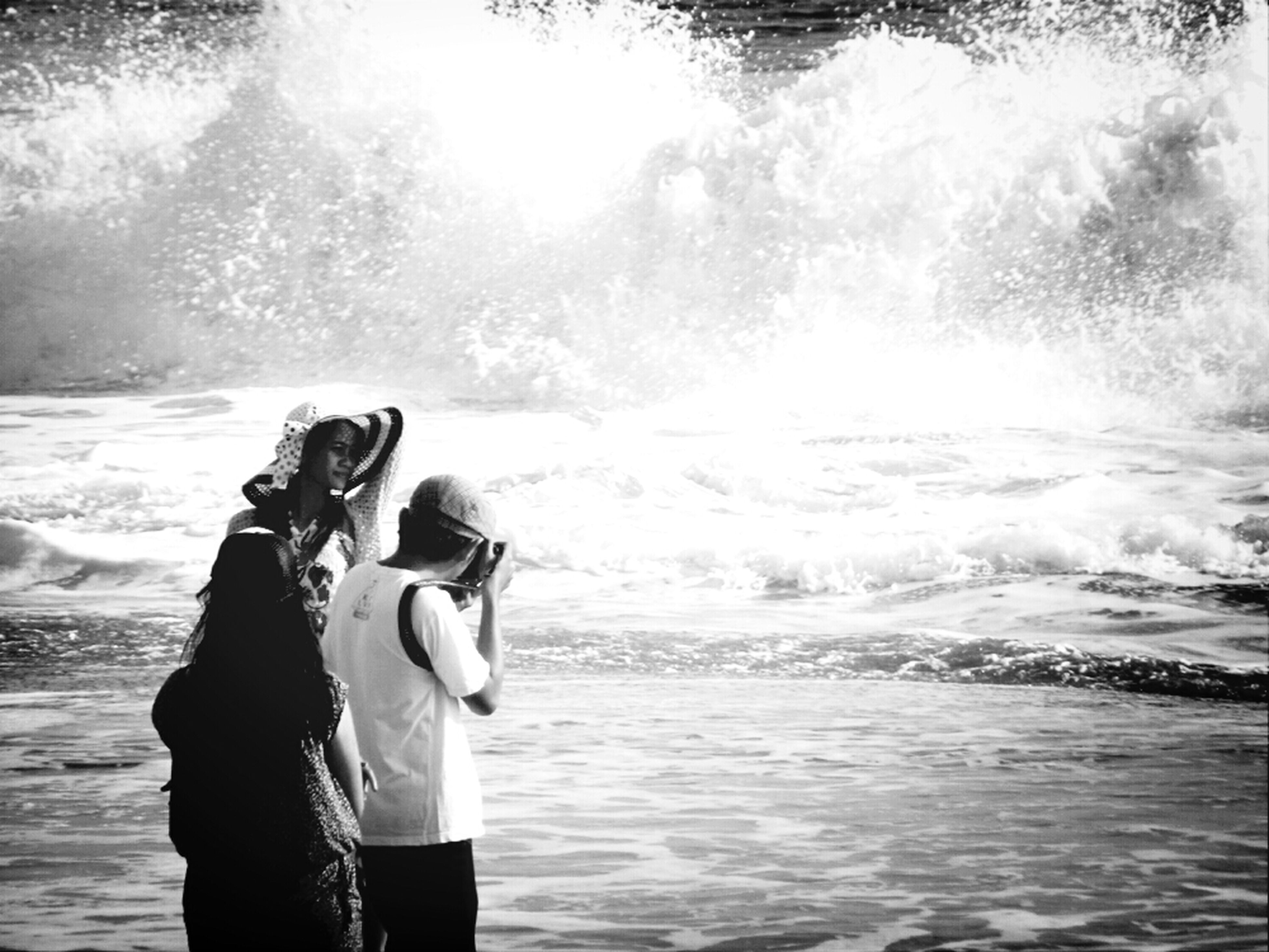 water, sea, lifestyles, leisure activity, rear view, beach, vacations, men, wave, standing, three quarter length, casual clothing, shore, togetherness, nature, boys, full length