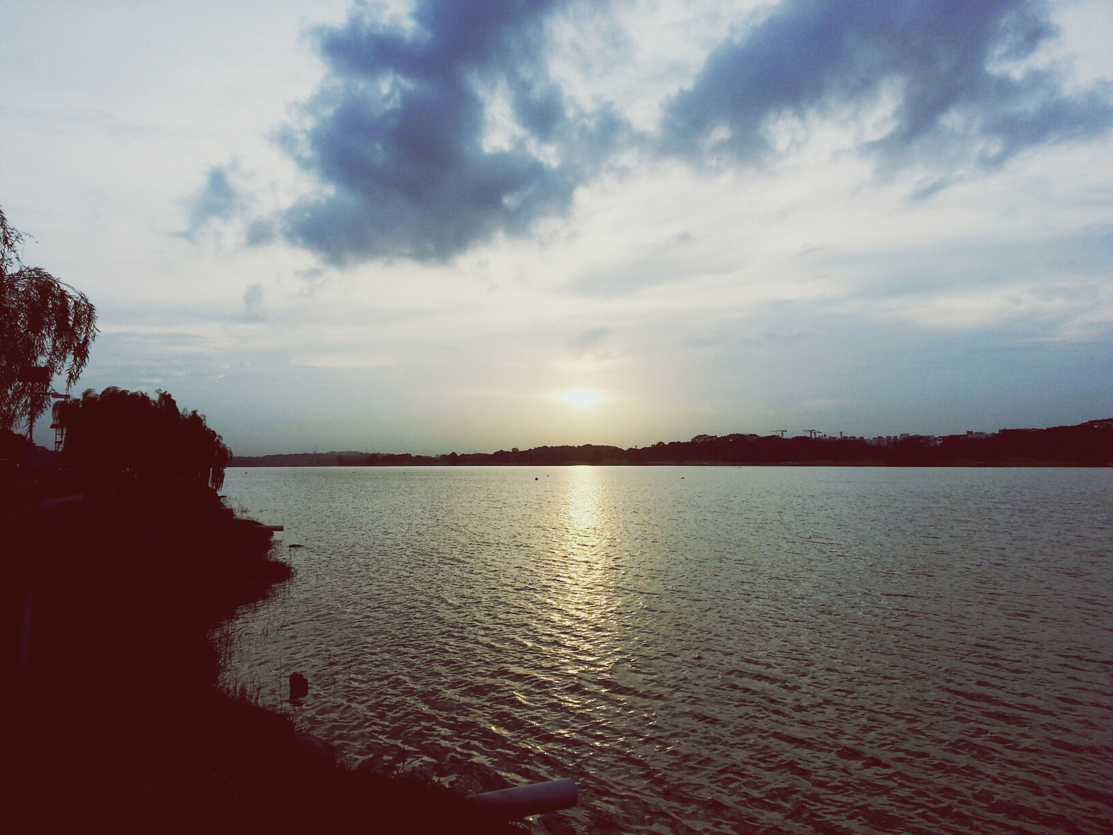 water, sky, tranquil scene, scenics, tranquility, sunset, beauty in nature, sun, cloud - sky, nature, silhouette, reflection, sunlight, lake, waterfront, tree, cloud, idyllic, river, rippled
