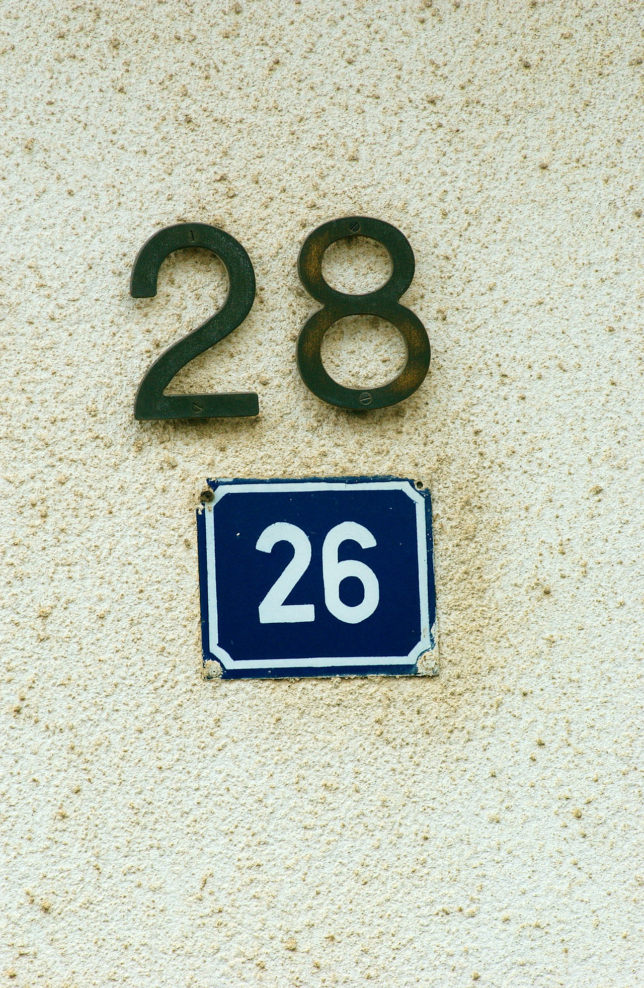 numbers 26 28 30 Close-up Day Door Number House Number House Number On Wall No People Number Plate Outdoors Plate