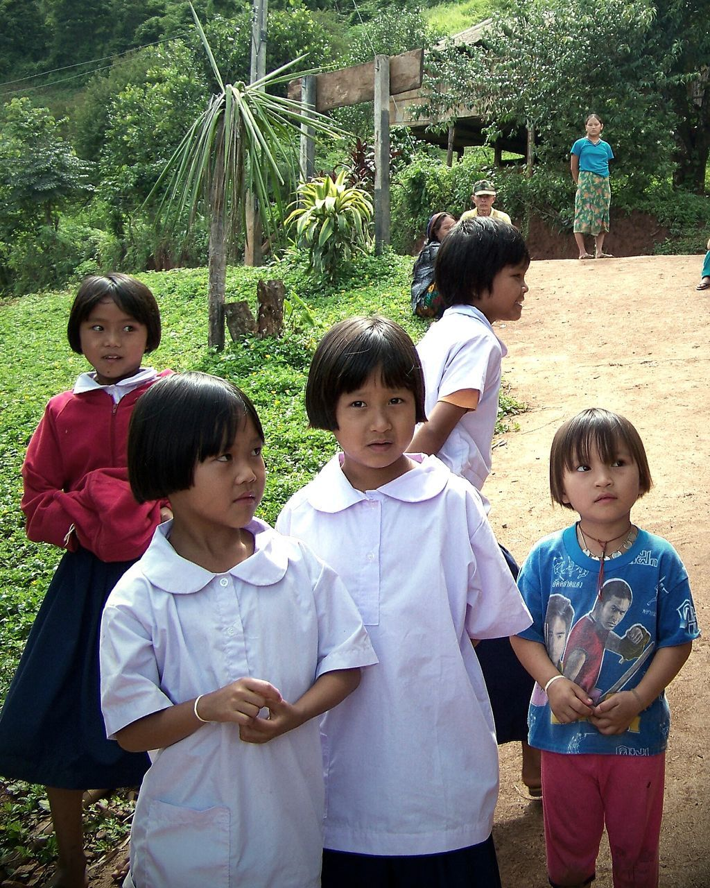 boys, childhood, girls, real people, education, elementary age, casual clothing, standing, leisure activity, day, medium group of people, tree, outdoors, fun, togetherness, lifestyles, growth, learning, smiling, happiness, school uniform, young women, child, nature, student, animal themes, young adult