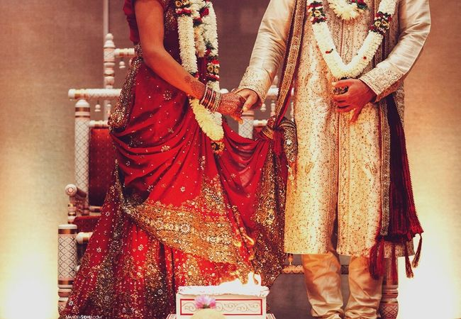 Bride 👰 & groom 🎩 Red Traditional Clothing Midsection Person Standing Cultures Sari People Bangle Glamour Wife Indoors  Jewelry Bride Wedding Horizontal Adult Togetherness Evening Gown Wedding Dress Wedding Photography Portrait Gold Groom Wedding Ceremony