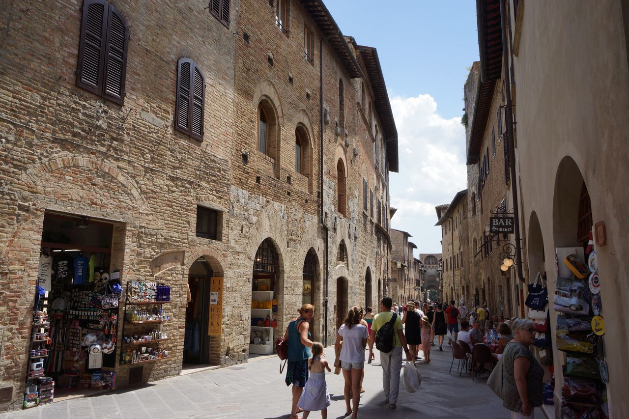 in the Roads Architecture Building Exterior Cultures Etruscan Civilization Historic Centre History Large Group Of People Manhatten Skyline Medival City Old Town San Gimignano Torre Toscana ıtaly Tourism Travel Destinations