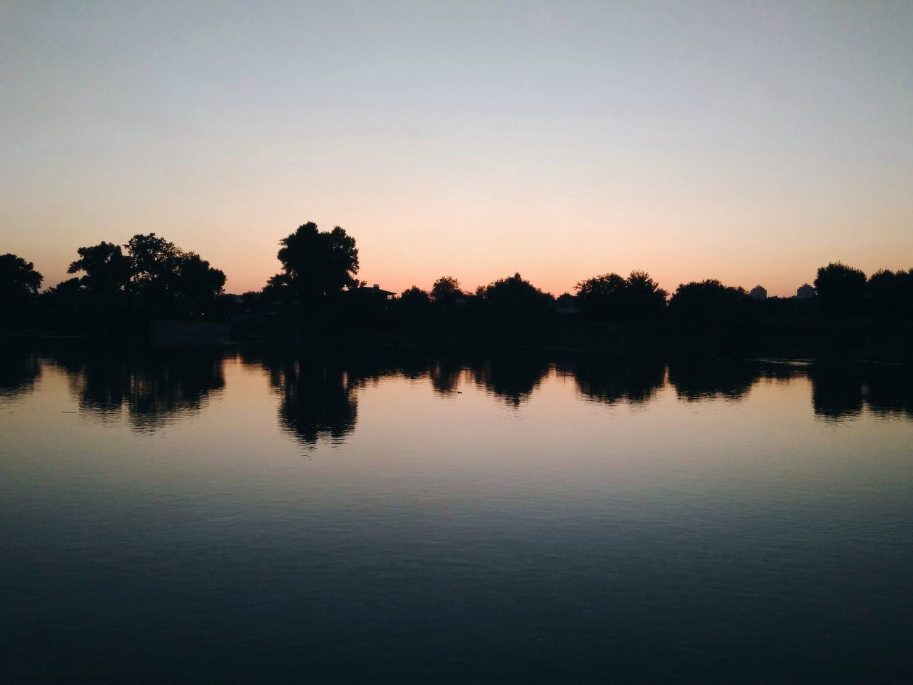 reflection, silhouette, sunset, water, tree, nature, tranquil scene, lake, scenics, beauty in nature, tranquility, waterfront, sky, dusk, outdoors, no people, clear sky