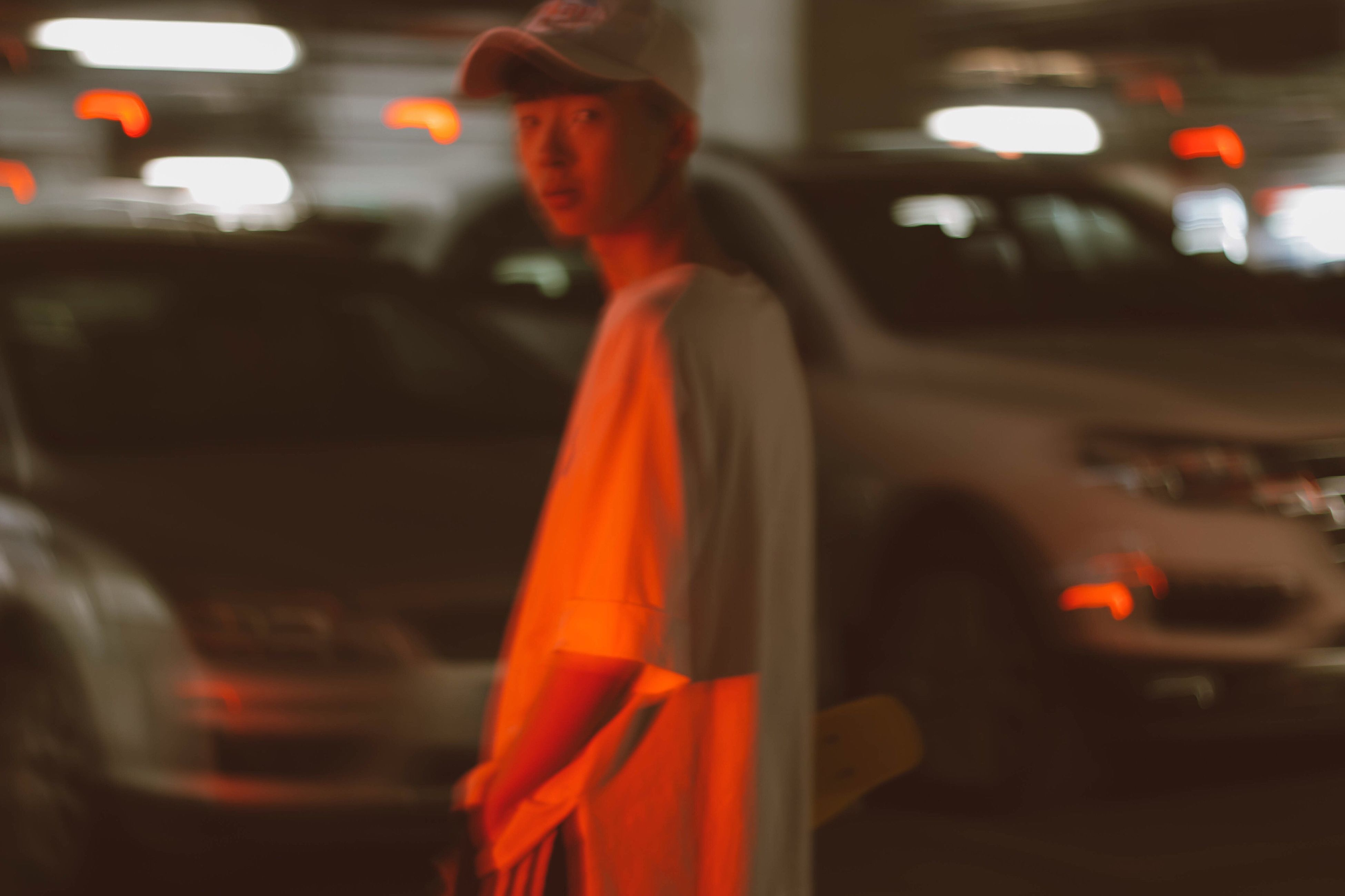 transportation, mode of transport, land vehicle, car, street, blurred motion, travel, focus on foreground, road, illuminated, on the move, incidental people, red, motion, city, public transportation, night, city life