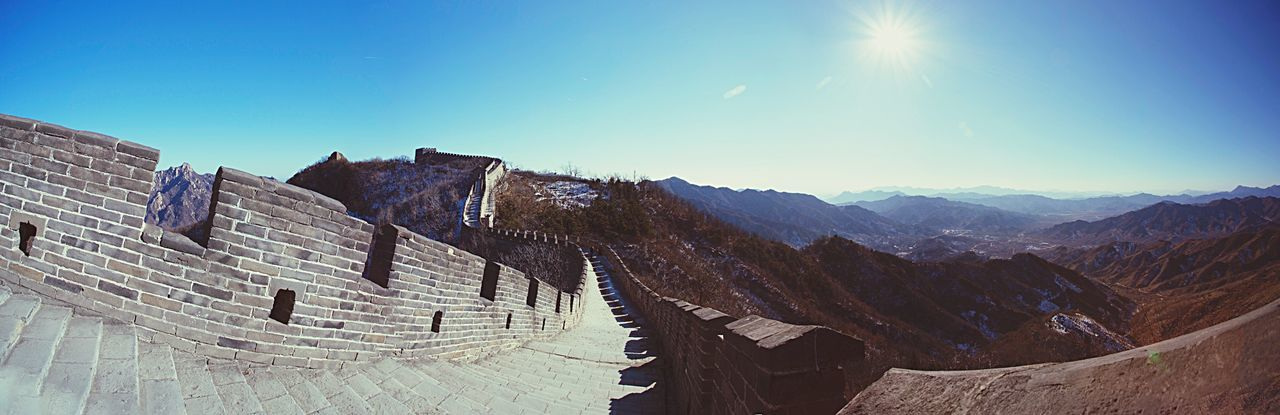 The Great Wall The Great Wall Of China Mountains Mountain Range View Landscape Panorama Nature Outdoors China Asian  Travel Traveling Heritage Culture History Architecture Travel Destinations Beauty In Nature Perspective Sunlight Blue Sky Chinese Beijing ASIA