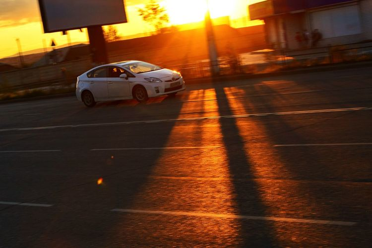 Car in motion on a sunset background. car, transport, road, route, traffic, speed, sun, Car Transportation City Street Speed Travel Road Street No People Sunlight Day Traffic City Sky Sunset Sunlight, Light, evening, morning, sunset, sunrise, dawn, EyeEmNewHere