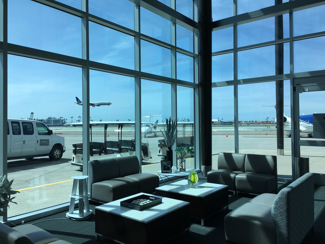 window, indoors, sky, table, transportation, day, luxury, no people, architecture, built structure, modern, seat