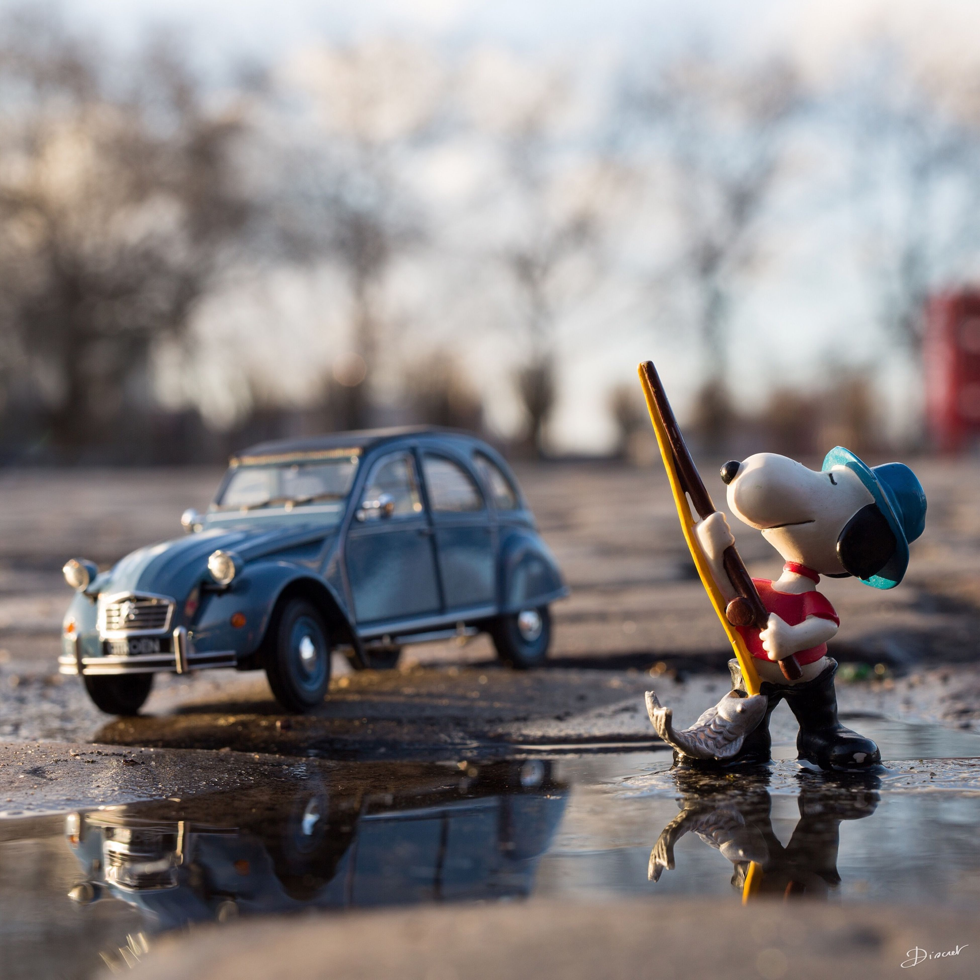 focus on foreground, close-up, selective focus, transportation, mode of transport, day, outdoors, no people, metal, toy, insect, water, still life, reflection, nature, single object, rope, bottle, abandoned, metallic