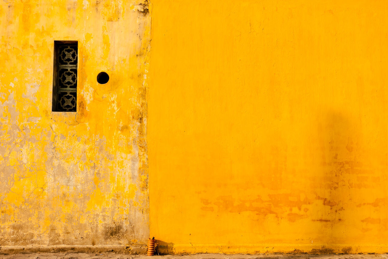 Full Frame Shot Of Old Yellow Wall
