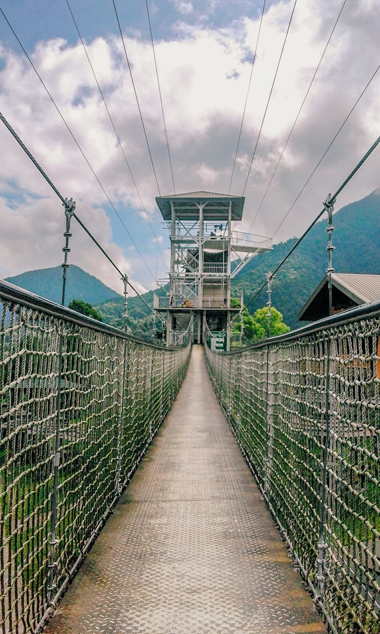 railing, connection, the way forward, sky, built structure, cloud - sky, bridge - man made structure, architecture, sea, day, outdoors, no people, cable, footbridge, nature, beauty in nature