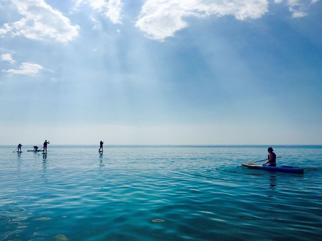 Sea Sky Beauty In Nature Water Horizon Over Water Scenics Nature Real People Outdoors Cloud - Sky Waterfront Tranquility Day Men Paddleboarding Nautical Vessel People Sup Stand Up Paddling
