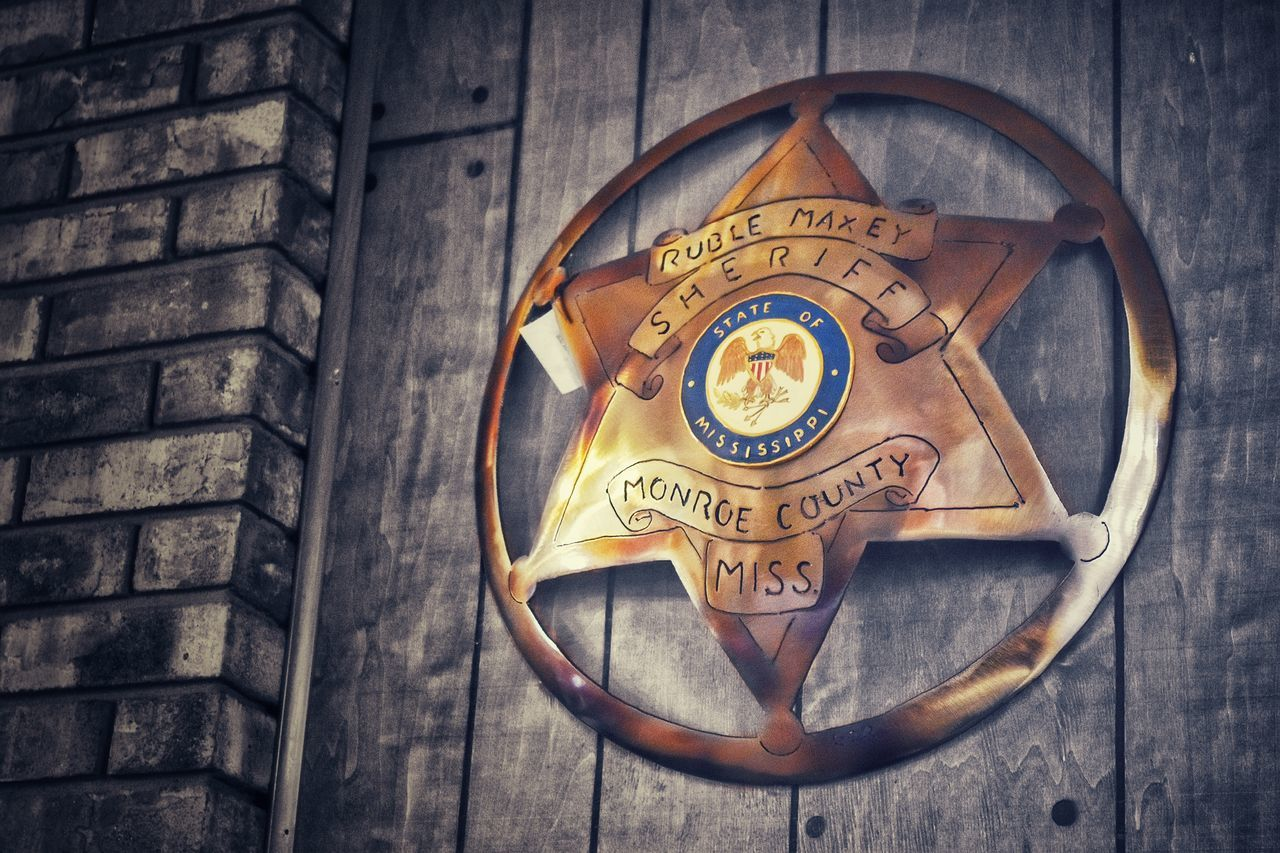 Wood Indoors  Paneling Lines Black And White Star Sheriff Disk Pop Of Color Law Enforcement Sheriff's Star Brick