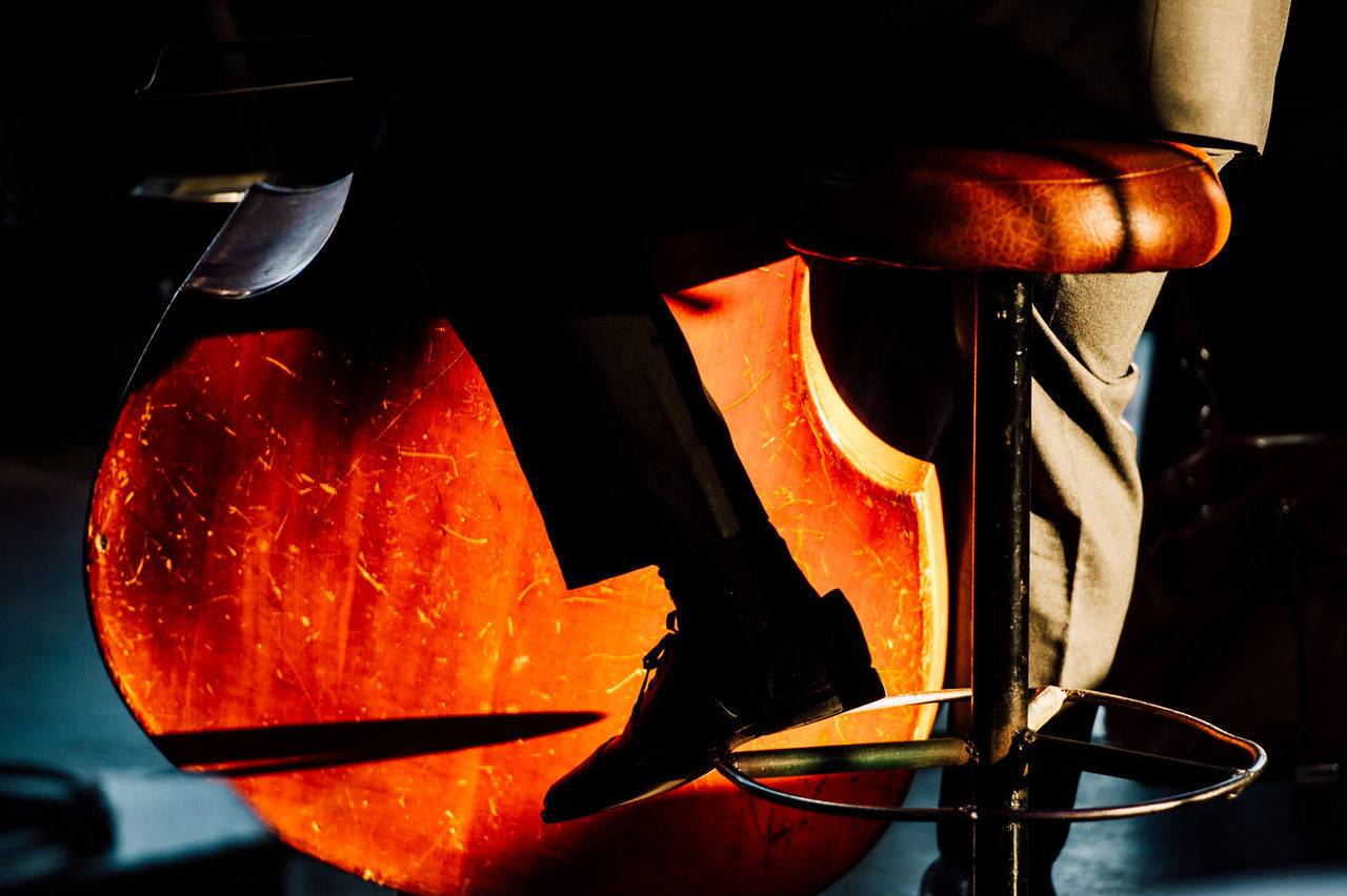 classical Classical music close-up contrabass indoors Jazz Music orange color playing music shoes Silhouette Sitting