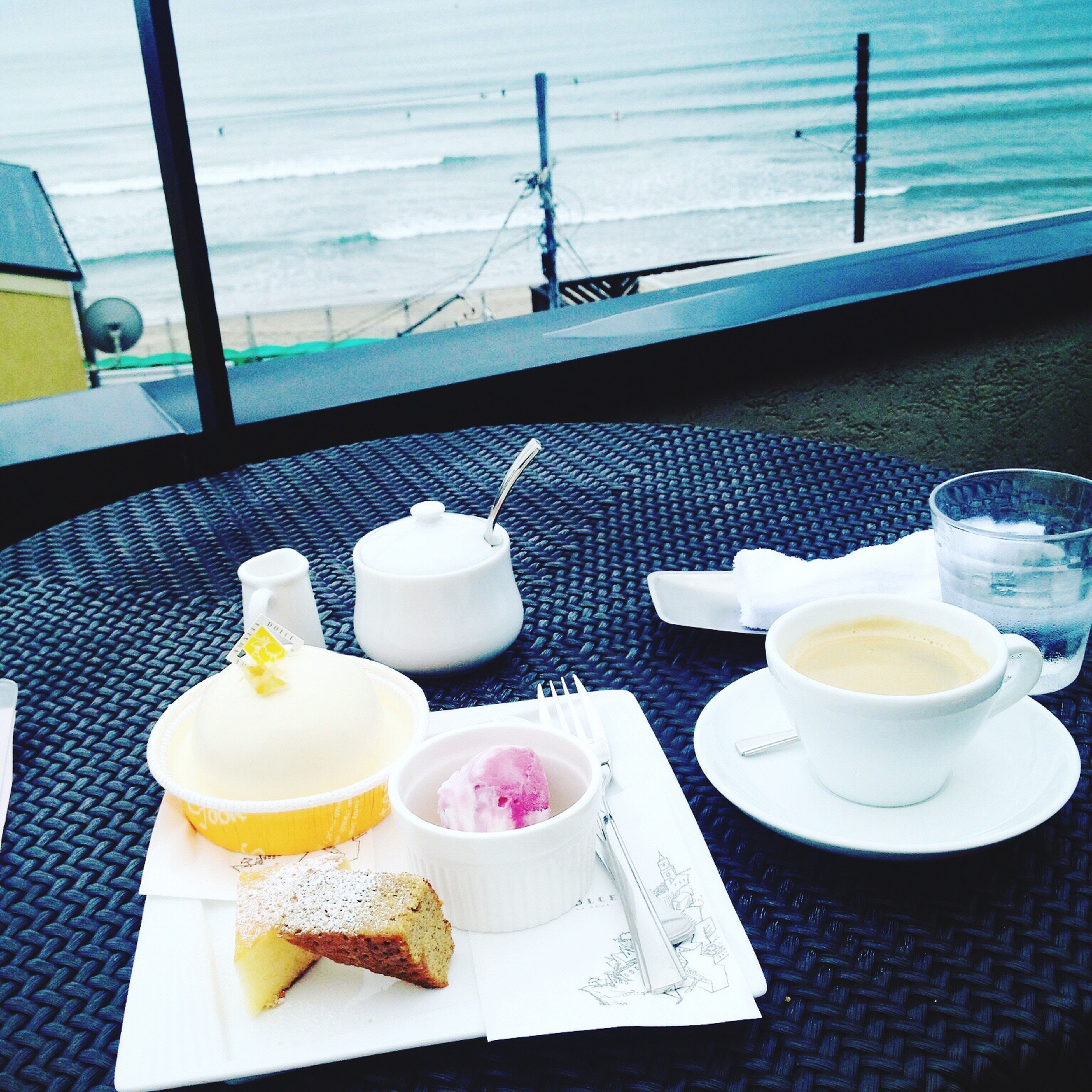 food and drink, plate, high angle view, drink, tea - hot drink, refreshment, no people, chair, freshness, water, table, breakfast, healthy eating, day, outdoors, drinking glass, sea, food, close-up