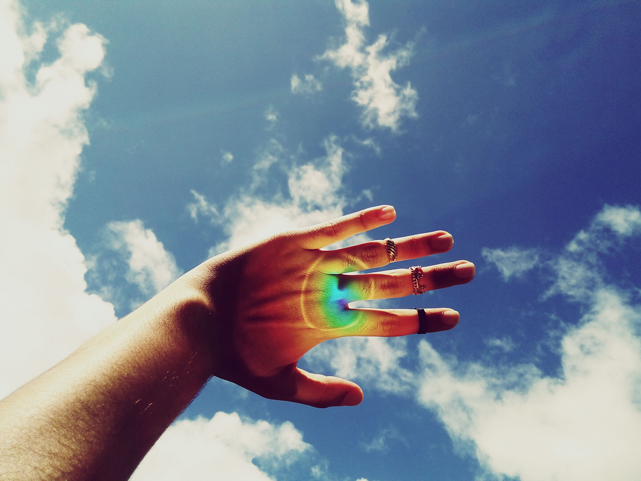 human hand, sky, human body part, cloud - sky, human finger, one person, personal perspective, real people, low angle view, outdoors, blue, day, holding, nature, close-up, beauty in nature, lifestyles, women, people
