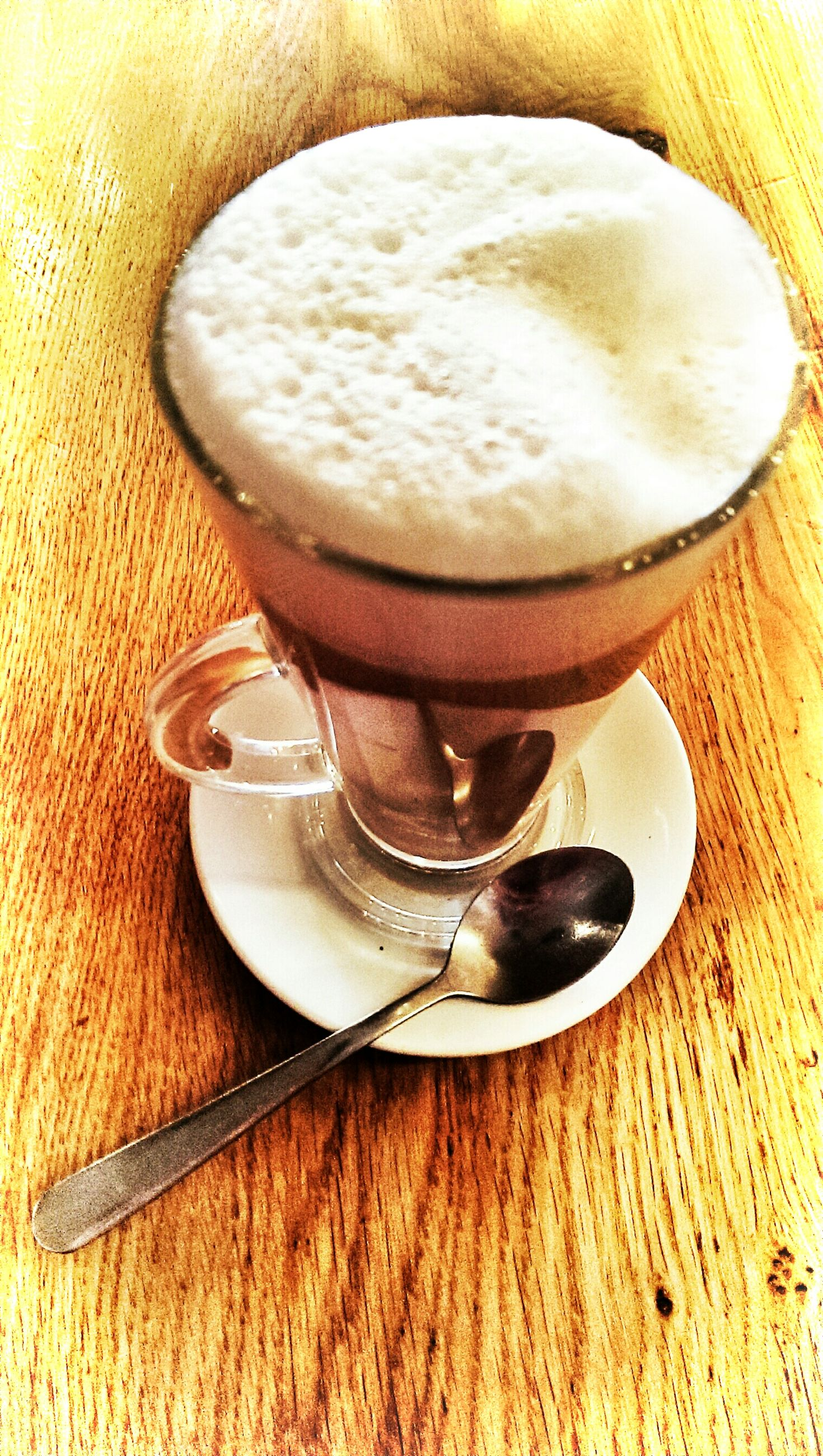 food and drink, indoors, drink, table, freshness, refreshment, still life, coffee - drink, coffee cup, frothy drink, close-up, spoon, high angle view, healthy eating, wood - material, coffee, directly above, food, cappuccino, saucer