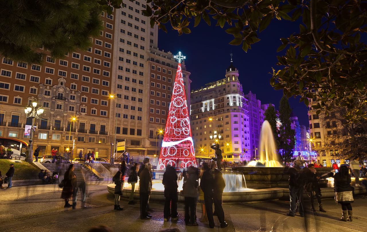 Christmas The Culture Of The Holidays Illuminated Night City Tree Travel Destinations Christmas Lights SPAIN Madrid Lonelyplanet Christmas Tree Christmas Around The World Christmas Time People Watching People Plaza De España Urban Landscape Landscape People And Places Overnight Success