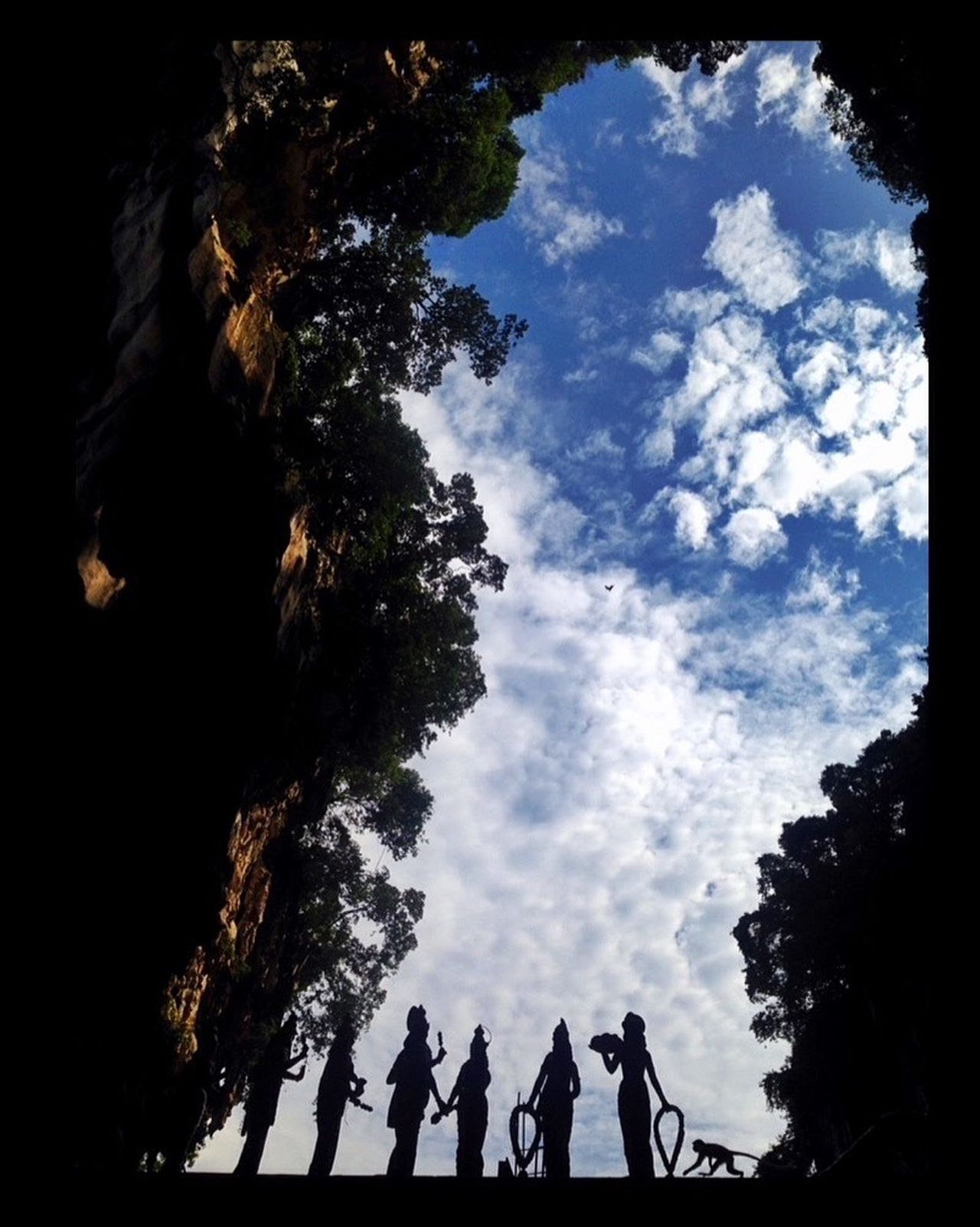 Batu Caves -Malaysia Batu Caves Temple Temple - Building Hindu Temple Kuala Lumpur Sillouette Statue Monkey Monkeys Clouds And Sky Clouds Cave Trees Trees And Sky Sky Blue Sky Mountains Dramatic Angles Iphone 5 IPhoneography Iphoneonly IPhone Eyeemphoto TakeoverContrast