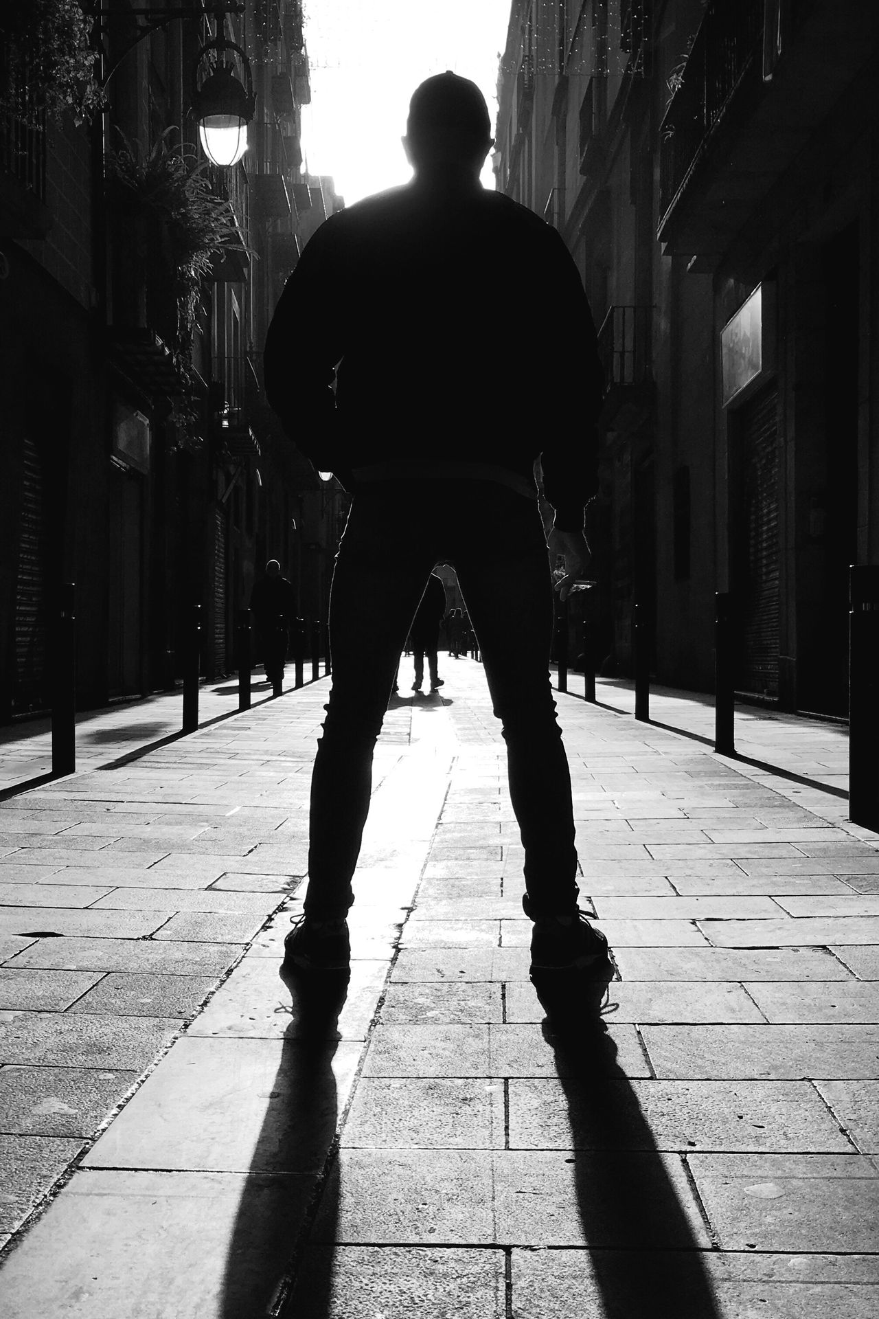 He owns the streets. The City Light One Person One Man Only Youmobile Mobilephotography Streetphotography Streetphoto_bw AMPt_community Silhouette Blackandwhite