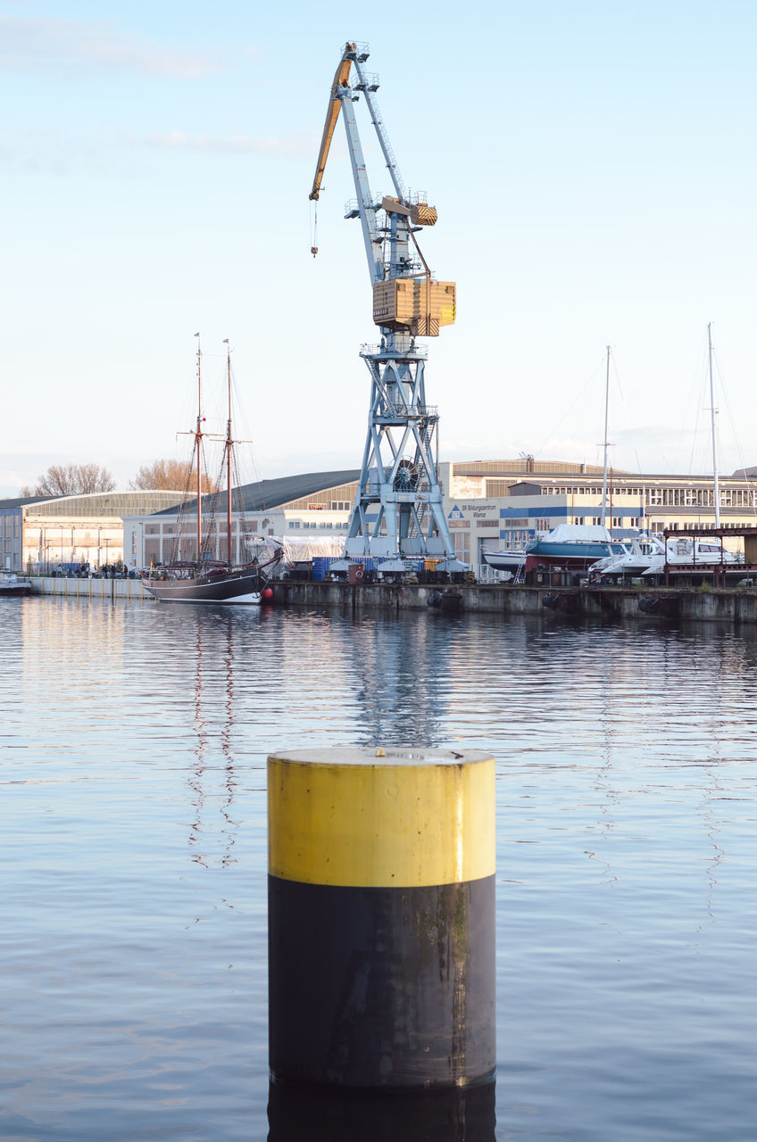 nautical vessel, harbor, no people, transportation, commercial dock, day, outdoors, water, industry, moored, sky, yellow, nature, shipyard, drilling rig, oil pump