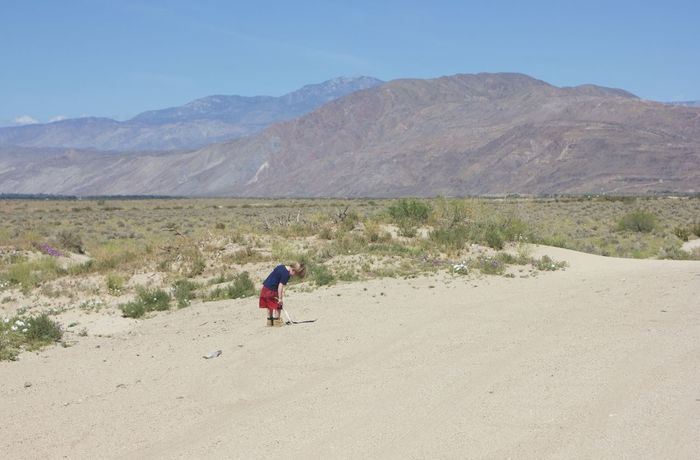 boy standing on side of deserted road Arid Climate Clear Sky Day Desert Landscape Mountain Nature One Person Outdoors People Real People Sand Scenics Sky Breathing Space Lost In The Landscape Connected By Travel Be. Ready. An Eye For Travel