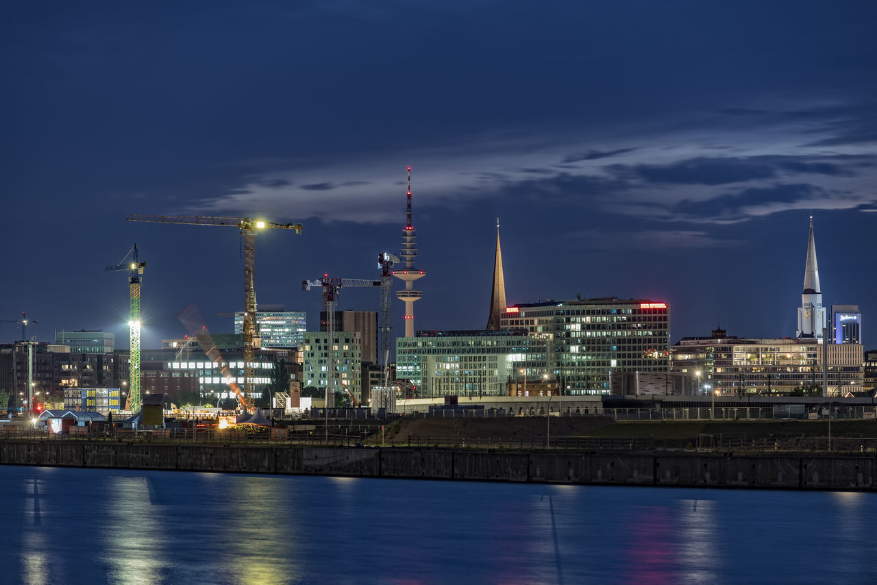 Hafencity Hamburg Architecture Business Finance And Industry Church Towers City Construction Site Cranes Der Spiegel Headquarter. Gas Hafencity Hamburg Illuminated Kai Night Night Photography No People Norderelbe Outdoors Petrochemical Plant Radissonblu Sky Skyscraper Tower TV Tower Urban Skyline Water