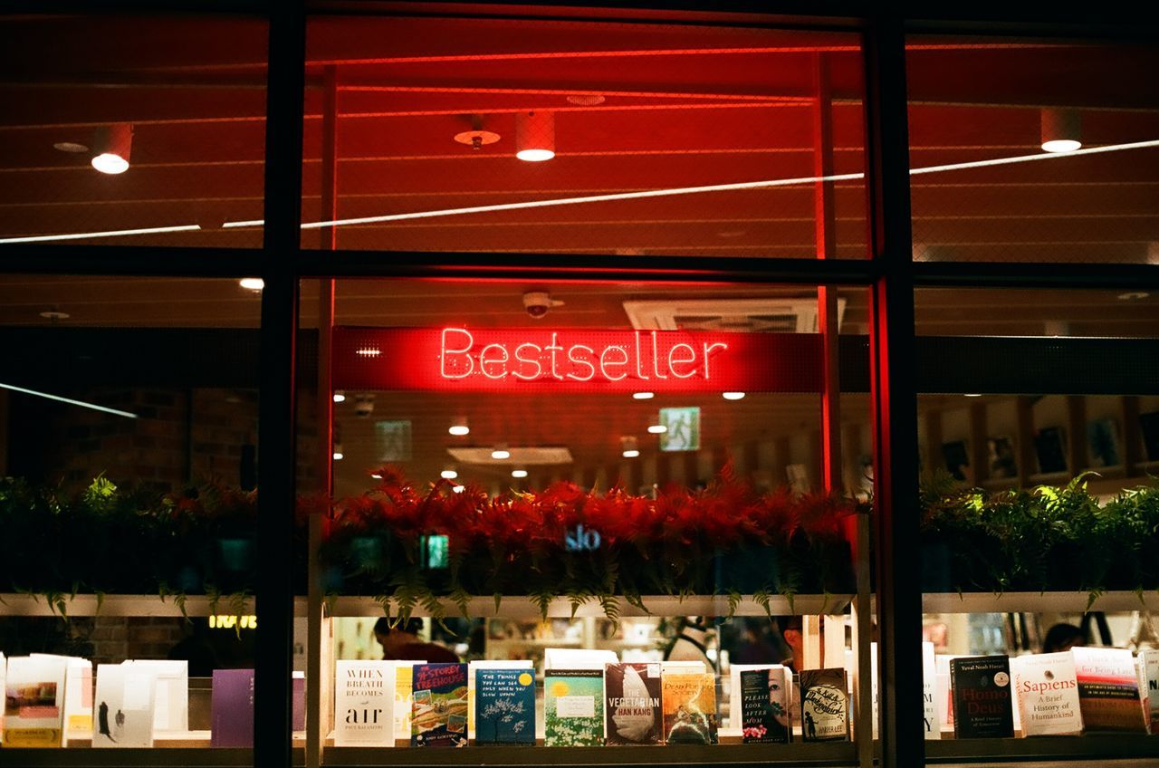 Best of best Minolta X700 Minolta bestsellers Bookstore retail Text store night consumerism communication indoors Choice Business no people neon