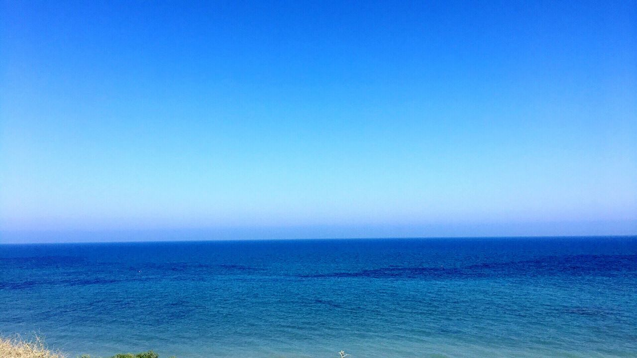 sea, blue, water, scenics, horizon over water, nature, beauty in nature, tranquil scene, tranquility, clear sky, copy space, outdoors, idyllic, no people, waterfront, day, sky
