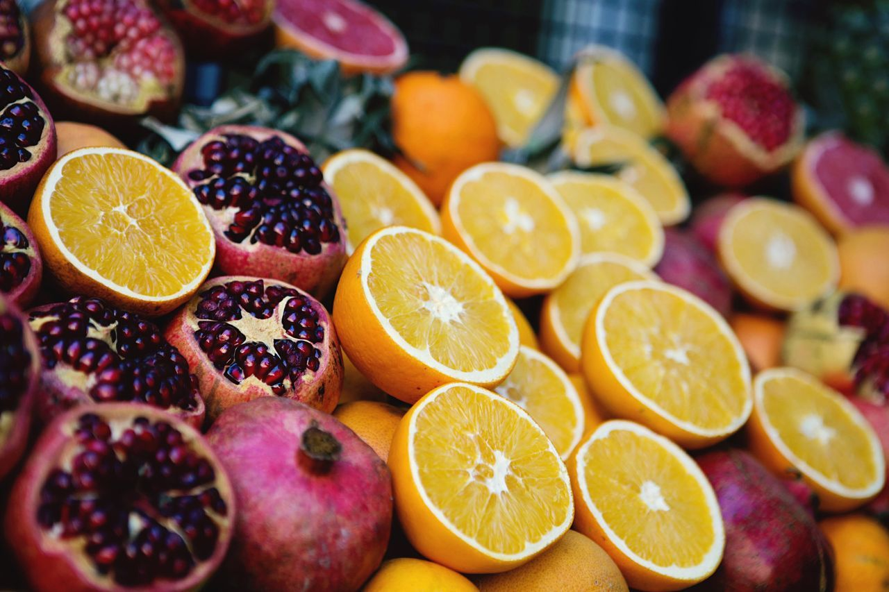 High Angle View Of Pomegranates And Oranges Stack At Market Stall