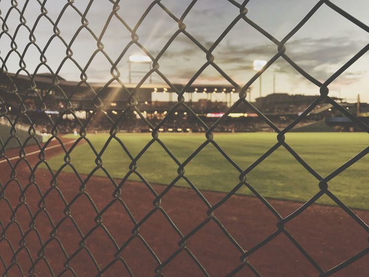 Chainlink Fence Sport Playing Field Baseball - Sport Baseball Player Outdoors No People Grass Day Sky Stadium Close-up