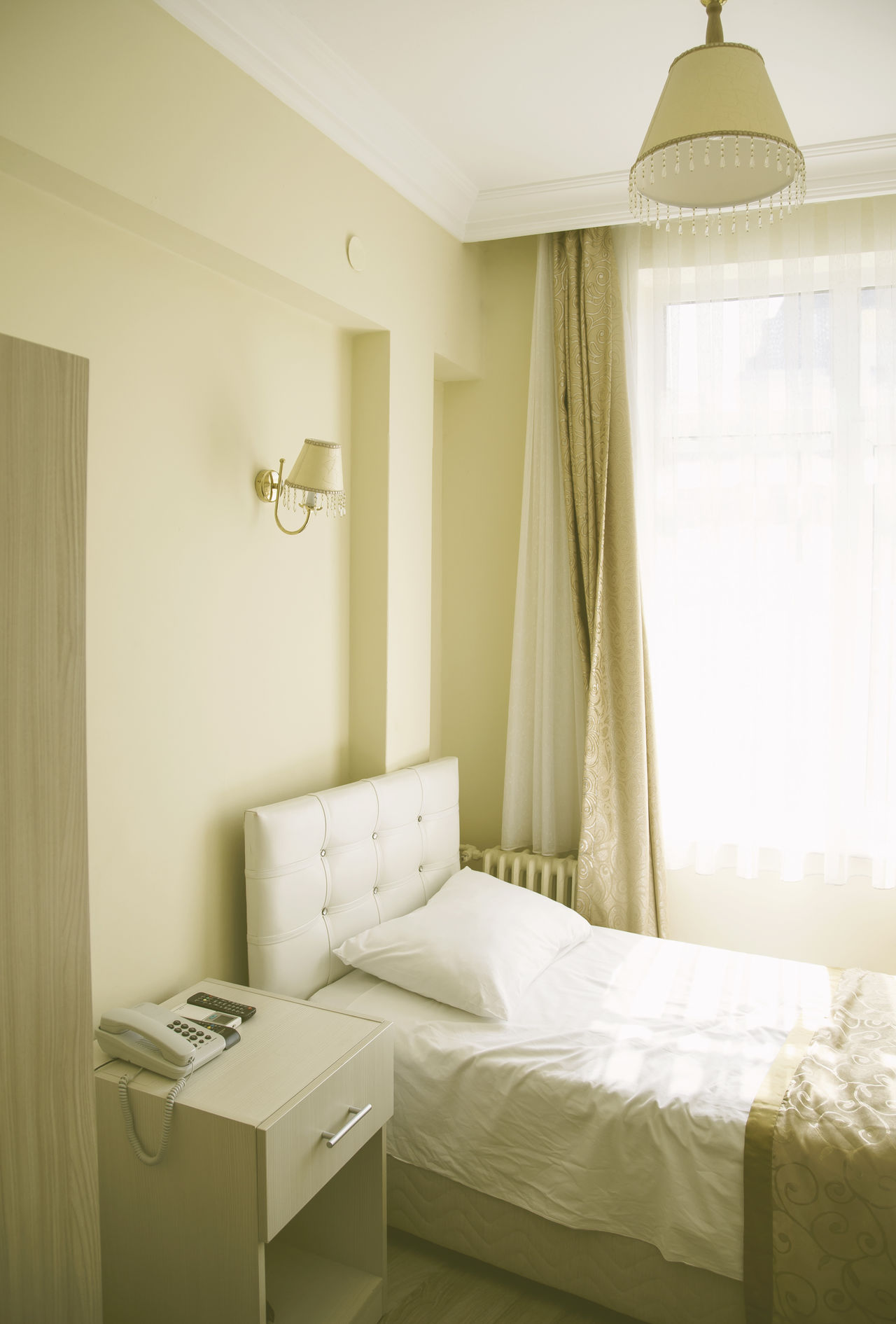 Bed Bedroom Comfortable Curtain Daylight Domestic Room Empty Home Home Interior Hotel Hotel Room Indoors  Morning Pattern Relaxing Single Small Telephone Wall