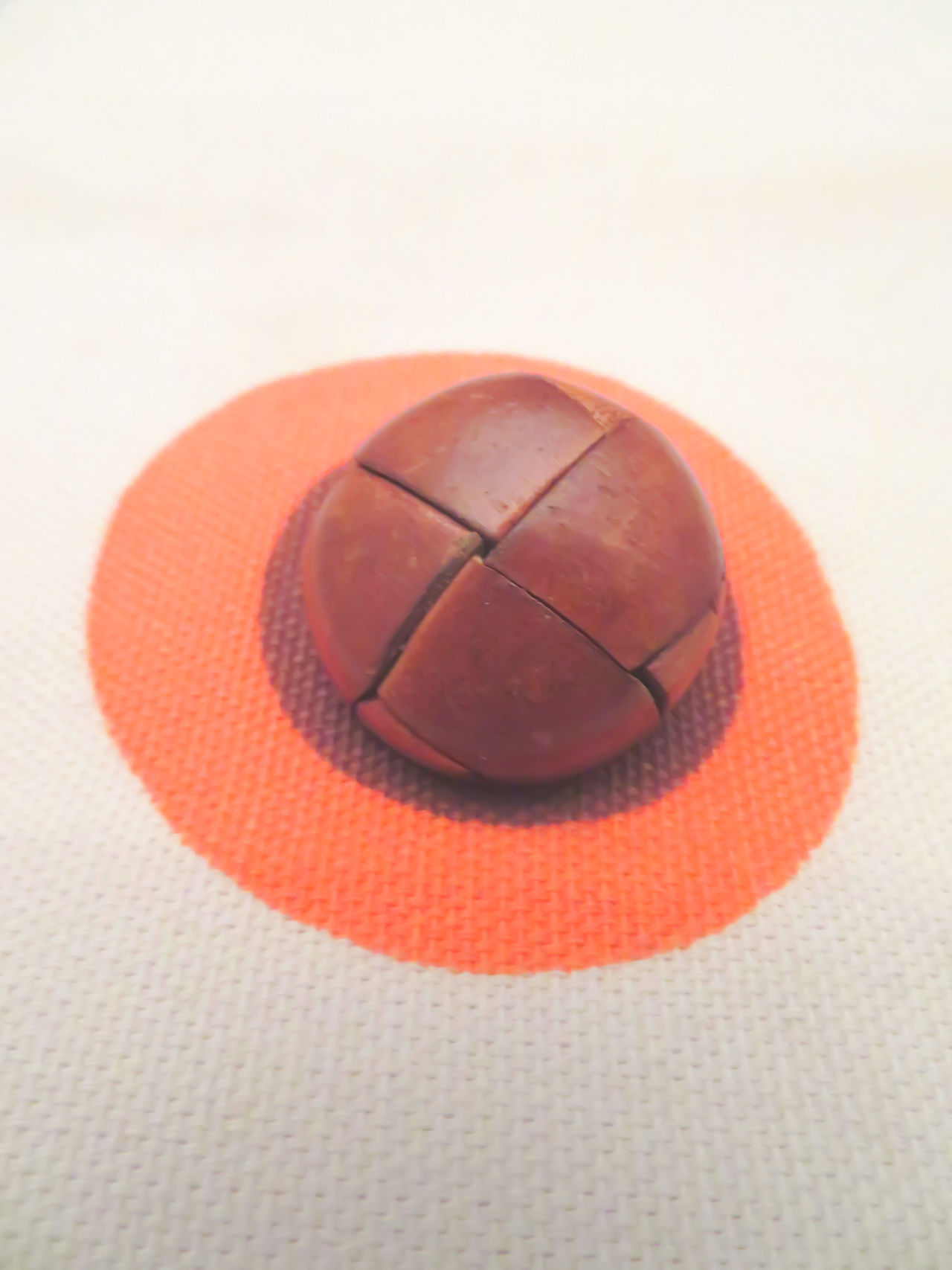 Close-up White Background Fabric Circles Button Brown And Orange Studio Shot