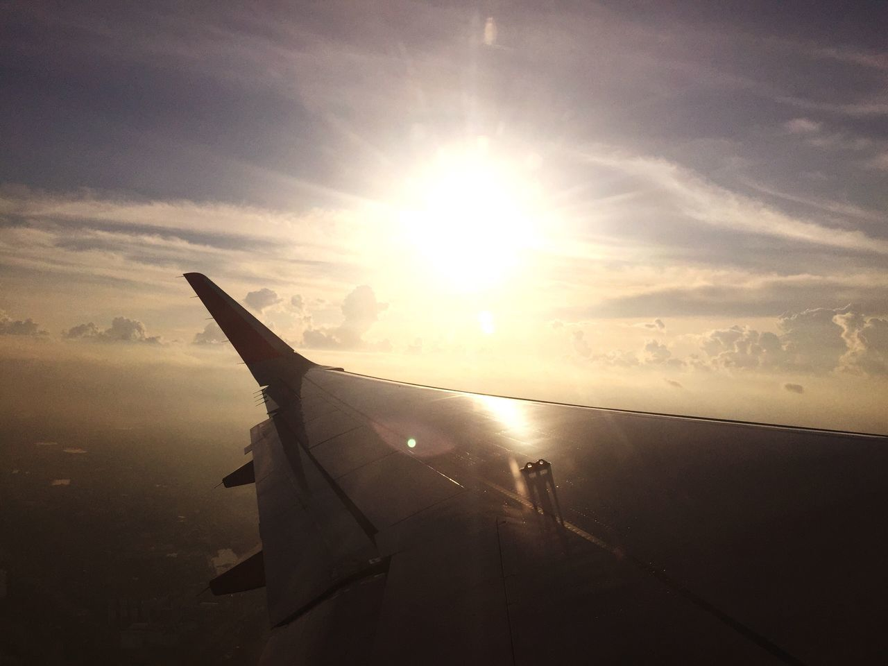 sun, sunbeam, sunset, lens flare, airplane, sky, transportation, sunlight, mode of transport, no people, aircraft wing, air vehicle, nature, cloud - sky, airplane wing, outdoors, close-up, beauty in nature, day