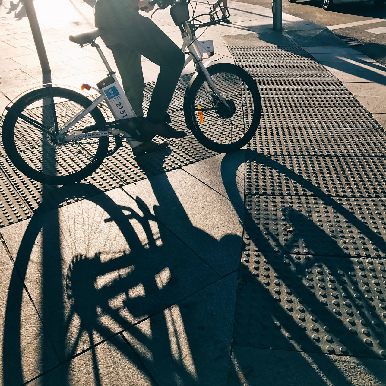 Bicycle Shadow Sunlight Day Outdoors Bicycle Rack Low Section Transportation High Angle View Mode Of Transport Real People Cycling Land Vehicle Lifestyles One Person Close-up People