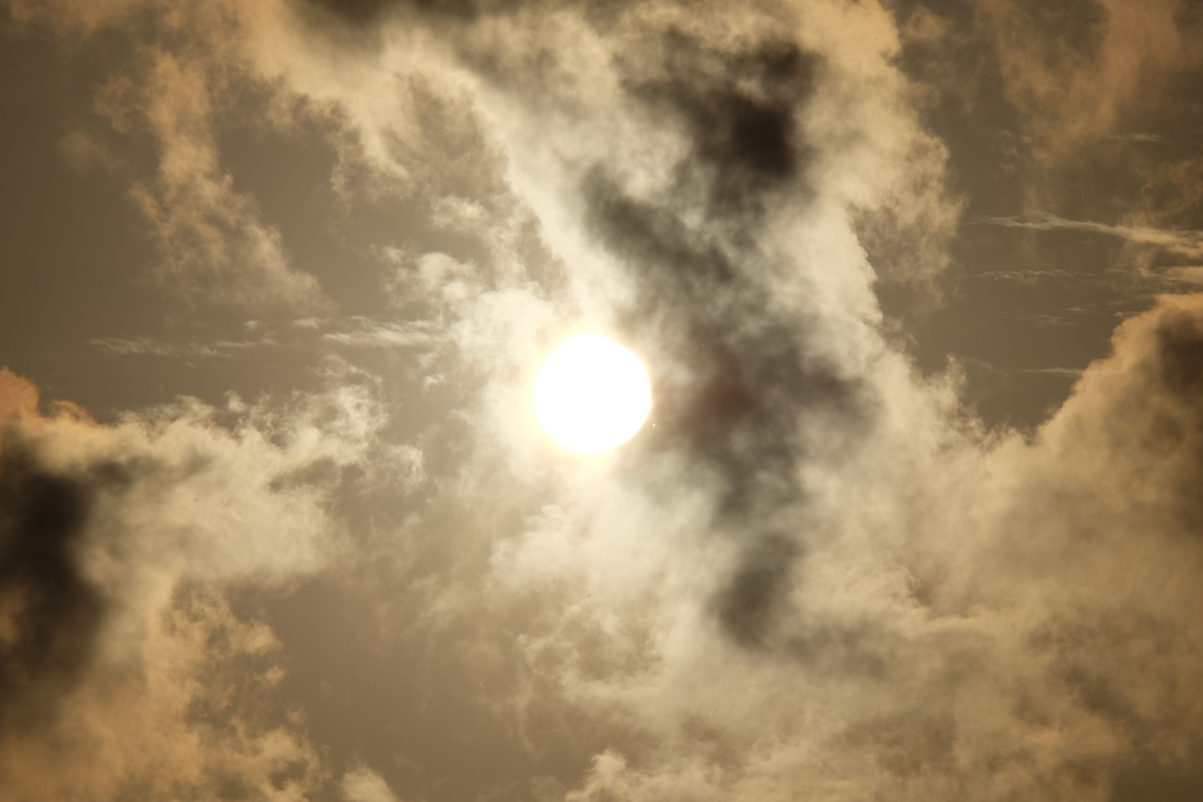 sun, beauty in nature, nature, low angle view, sunlight, sky, tranquility, sunbeam, cloud - sky, outdoors, scenics, no people, day, solar eclipse