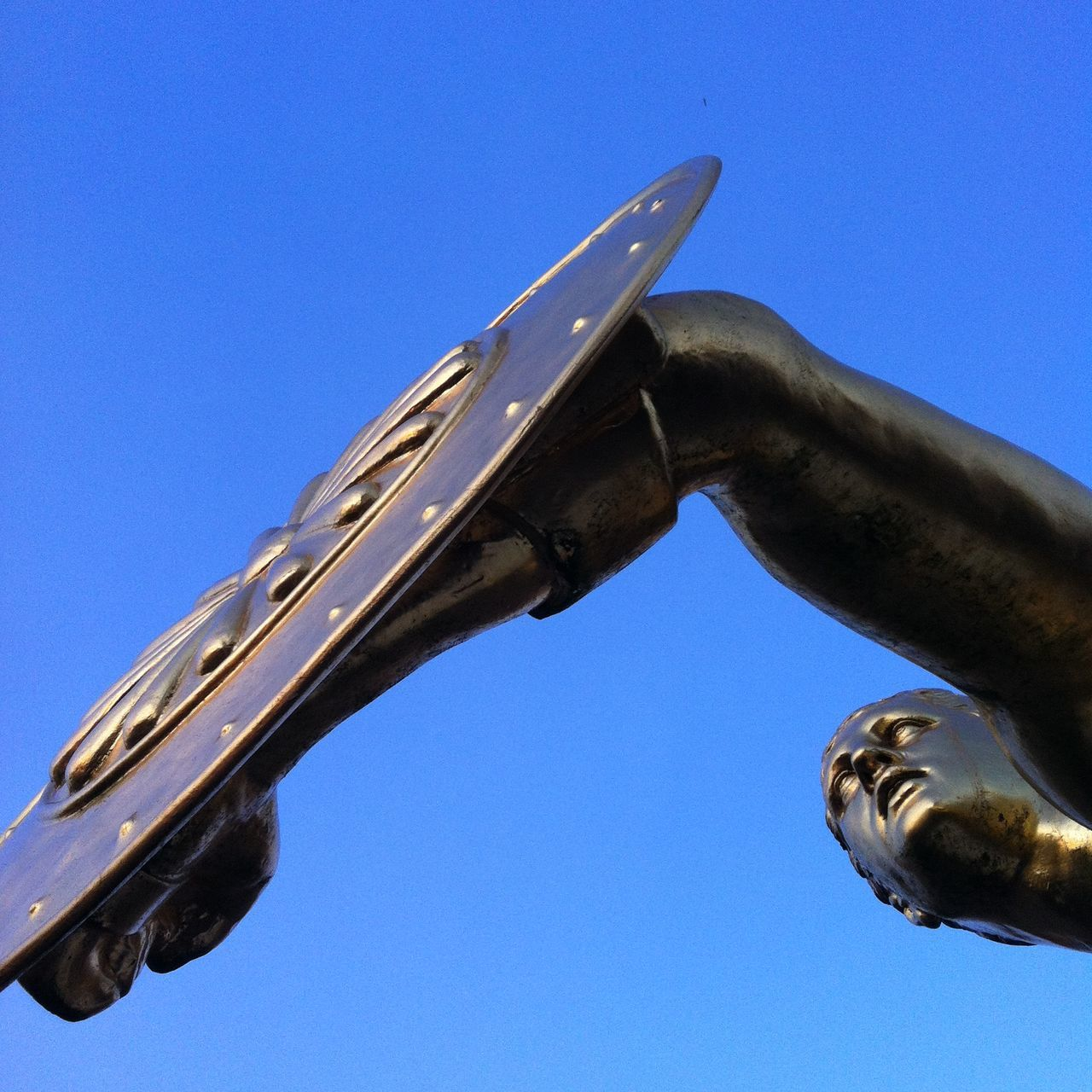 clear sky, low angle view, blue, no people, outdoors, metal, day, sculpture, close-up, statue, sky