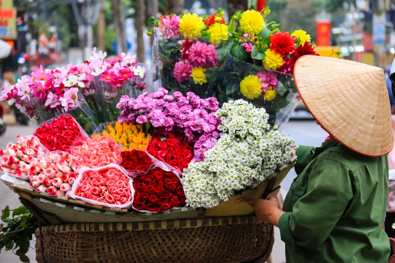 women selling flowers on the streets by biclcle Basket Choice Close-up Day Flower For Sale Fragility Freshness Market One Person Outdoors People Real People Retail  Small Business Variation