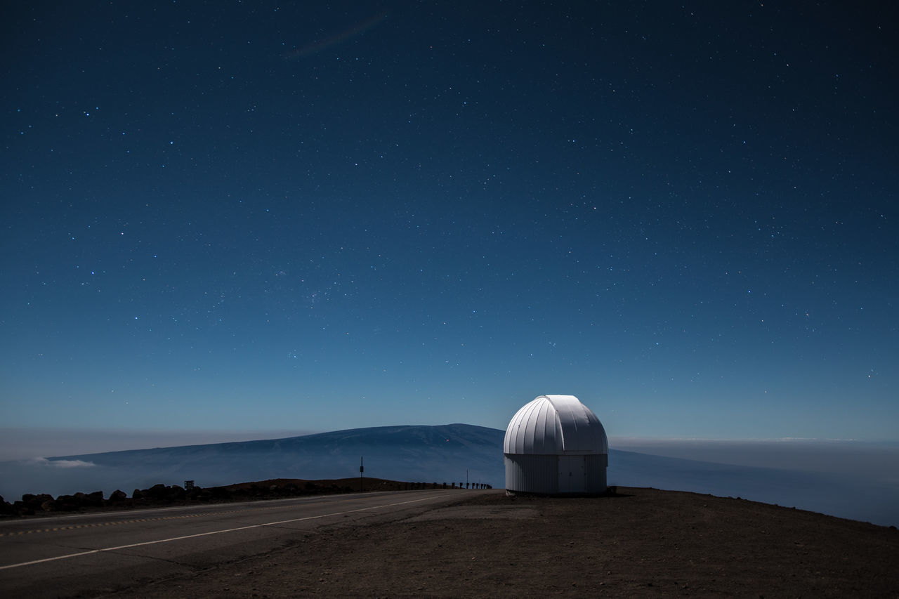 Mauna Kea Observatories With Volcano Against Sky