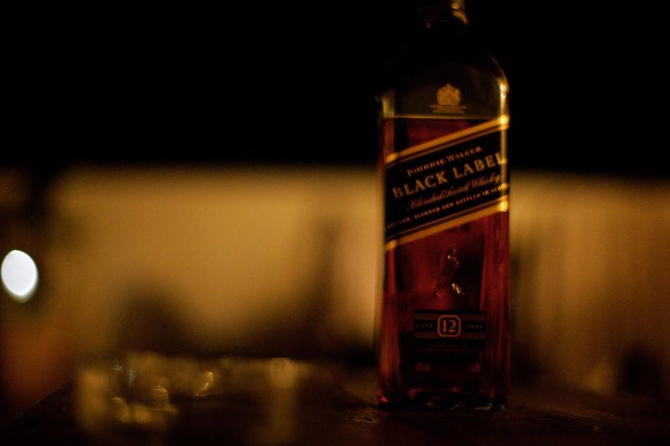 Bourbonwhiskey Black Label Whiskey Night Close-up On The Rocks Text EyeEm Check This Out Uruguay The Week On Eyem EyeEm Gallery Hello World Things I Like Taking Pictures EyeEm Best Shots Full Frame Night With Friends Scottish No People Party Bottle Glass Amber